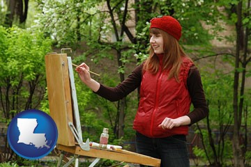 a female plein air artist painting with oils on a portable easel - with Louisiana icon
