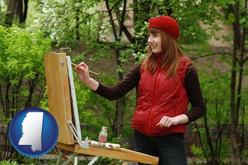 a female plein air artist painting with oils on a portable easel - with Mississippi icon