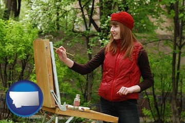 a female plein air artist painting with oils on a portable easel - with Montana icon