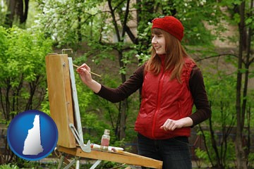 a female plein air artist painting with oils on a portable easel - with New Hampshire icon