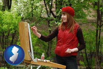 a female plein air artist painting with oils on a portable easel - with New Jersey icon