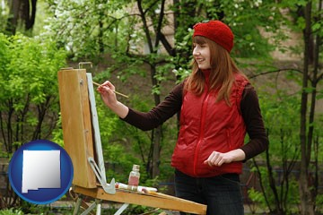 a female plein air artist painting with oils on a portable easel - with New Mexico icon