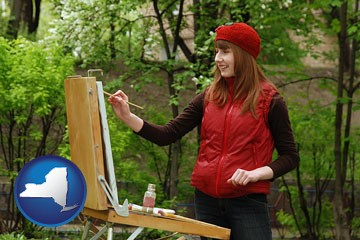 a female plein air artist painting with oils on a portable easel - with New York icon
