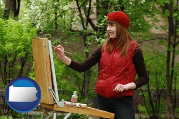 a female plein air artist painting with oils on a portable easel - with Pennsylvania icon