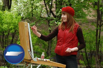 a female plein air artist painting with oils on a portable easel - with Tennessee icon