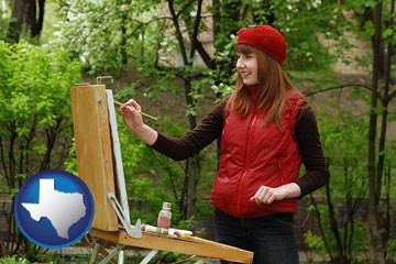 a female plein air artist painting with oils on a portable easel - with Texas icon